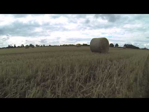 TBS Discovery Quadcopter - Flying very low and fast through the hay bales. - UCA9kQj0XD8v5TF_vqbHF1zg