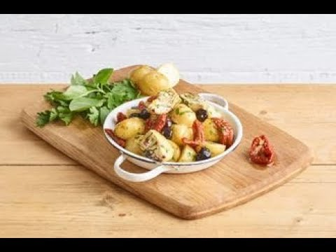 Quick-pickled potato salad with capers, olives and artichokes