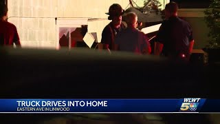 Police: Truck drives into home, almost hits grandmother sitting inside