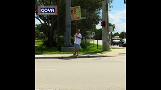 South Florida man stands on street corner in search of lost dog