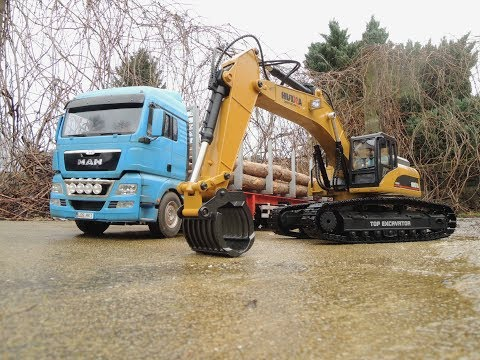 Huina full metal excavator & Tamiya MAN tgx w. log trailer - UCfQkovY6On1X9ypKUr9qzfg