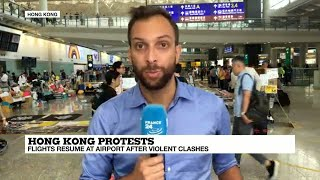 Hong Kong protests: Flights resume after violent clashes