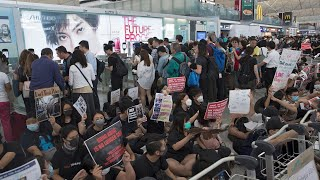 Watch live: Hong Kong airport cancels flights for second day as protesters reoccupy terminal