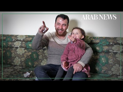 Syrian father and three-year-old daughter laugh off the shelling