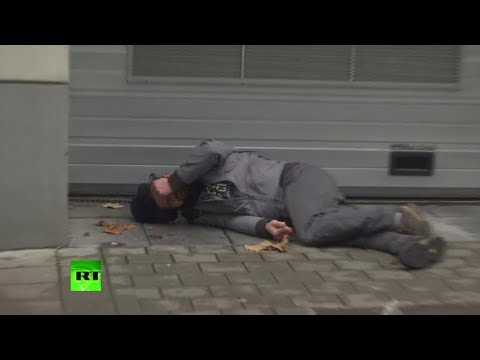 Man collapses & left helpless after being pepper-sprayed at close range during Brussels protests