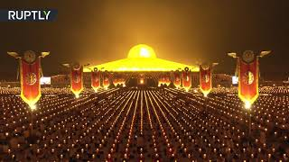 Thailand | Buddhists mark full moon festival with dazzling light show