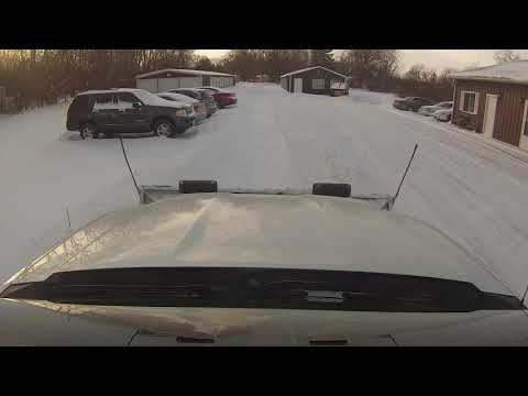 PARKING LOT SNOWPLOWING GMC BOSS PLOW