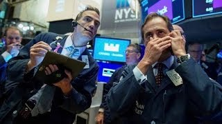 Stocks hit all-time high, raising 'wall of worry' concerns