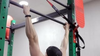 The Athlete Performs Exercises on the Crossbar | Stock Footage - Videohive