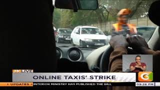 Online taxi drivers say low pay behind strike