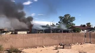 Watch: At least 2 displaced after house fire on Tucson's south side