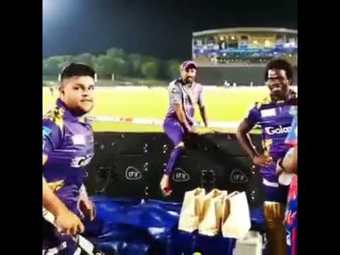 Azam Khan Taking Signature On His Bat From Andre Russell