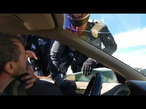NM State Police officer breaks out driver's window