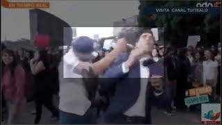 Sujeto golpea a Juan Manuel Jimenez de ADN 40 durante protestas en la Glorieta de los Insurgentes