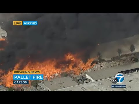 Massive 3-alarm fire fueled by burning pallets erupts at commercial facility in Carson | ABC7
