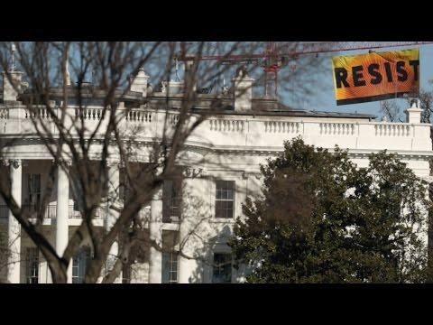 Greenpeace activists climb crane