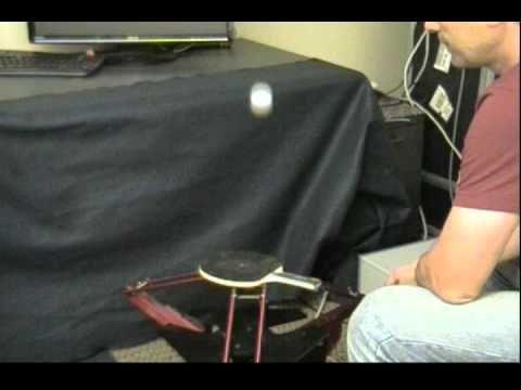 Robot juggles two ping-pong balls