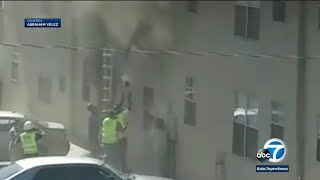Construction workers rescue toddler and baby boy from burning building   ABC7