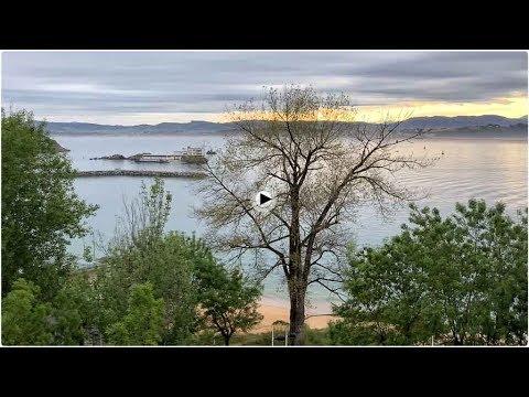 Un amanecer con espigón e isla