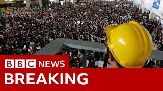 Hong Kong airport cancels flights over protests - BBC News