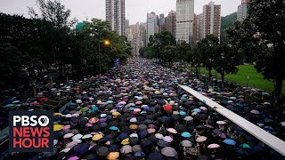 Nearly 2 million protest in Hong Kong, as Chinese forces gather near the border
