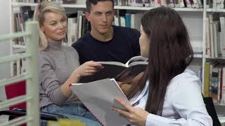 Young Female Student Smiling To the Camera While Talking To Her Friends at Library | Stock Footage