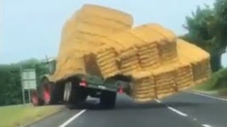 Truck carrying bales of hay overturns after losing balance