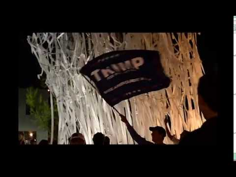 Supporters of Donald Trump gather at Toomer's Corner to roll the trees after he was announced as president-elect.