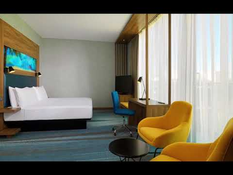 Aloft Palm Jumeirah guestrooms, using the great balance of blue and yellow, giving the rooms a snug ambiance.  Products Supplied: furniture, lights, and artworks    #bestbedroomdesigns #bestguestroomdesigns #highqualityfurnitureuae
