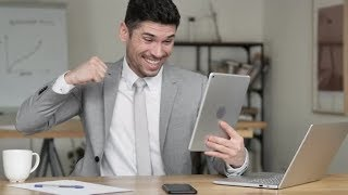 Businessman Celebrating Success while Using Tablet | Stock Footage - Videohive
