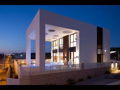 Minimalist Modern House Design with Unique Structure of Pergola Creates the sense of Openings