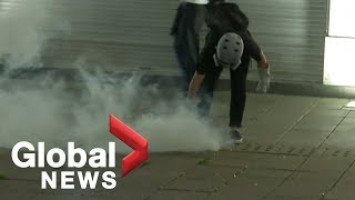 Hong Kong police fire tear gas at protesters as clashes continue