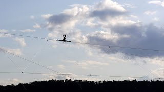 Tightrope walker crosses over Vltava River| CCTV English