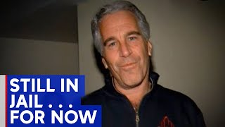 Financier Jeffrey Epstein will remain jailed as judge mulls bail