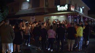 Slain officer couldn't leave female bartender at gunpoint