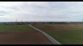 Aerial Drone Content Road with Light Traffic on Outside City and Arable Lands | Stock Footage -