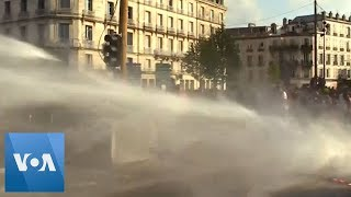 Police Fire Water Cannons Against G-7 Protesters