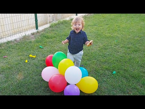 Cute Baby Playing with Party Balloons and Laughing