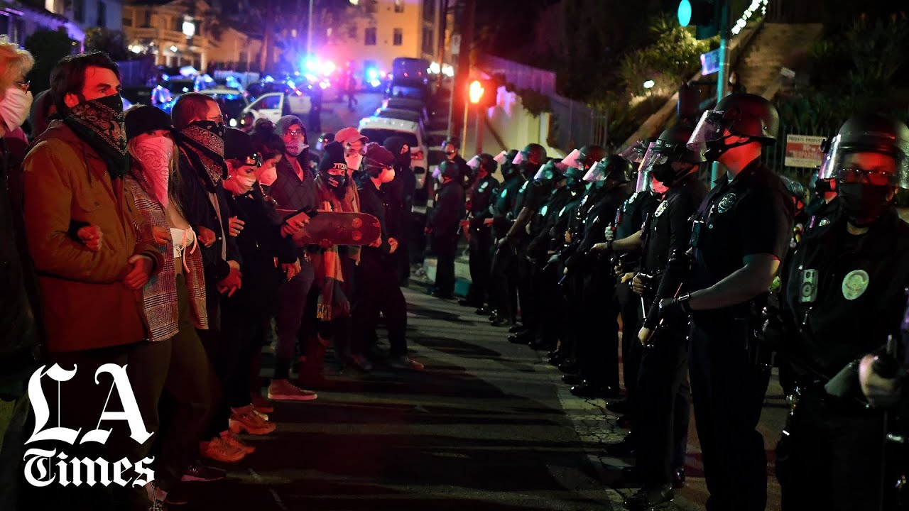 Crackdown at Echo Park homeless encampment begins as LAPD moves in, clashes with protesters
