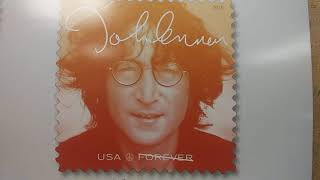 John Lennon Has His Own Postage Stamp Now! Sign at the Post Office at the Corner of Main Street and