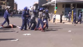 Protests In Zimbabwe Turn Violent As Police Beat Peaceful Protestors And Fire Tear Gas