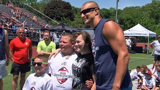 RAW VIDEO: Gronk Helps Deployed Cousin Surprise Boys At Football Clinic