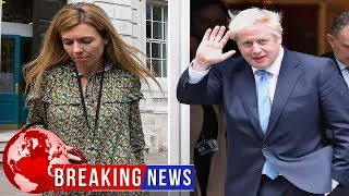 Boris Johnson puts arm around smiling girlfriend Carrie as they enter No10 by the backdoor at midnig