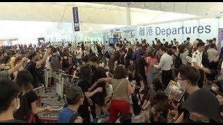 Violent Activists Paralyze HK Airport, Injure 2 People