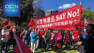 Los ciudadanos chinos residentes en Australia se congregan en Sídney como muestra de apoyo a China